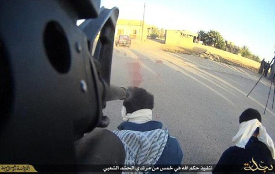 Spy executed in Islamic State. Notice they have attached cameras to their guns for horror photos.