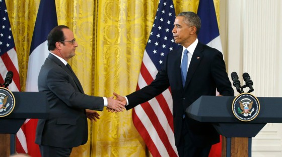 U.S. President Obama greets French President Hollande during joint news conference at the White House in Washington