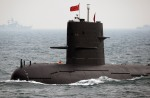 Chinese Navy submarine takes part in an international fleet review to celebrate the 60th anniversary of the founding of the People's Liberation Army Navy in Qingdao