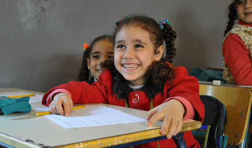 Syrian child at double-shift class in Lebanon 1