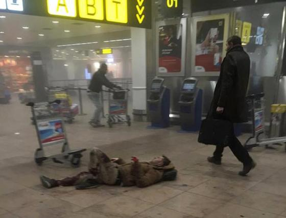 An injured man is seen at the scene of explosions at Zaventem airport near Brussels,