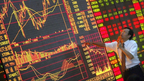 A dealer analyses the shares index to in